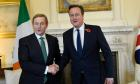 Britain says Irish won't be affected by benefits curbs on EU migrants